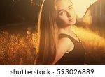 blond girl in warm sunset light ... | Shutterstock . vector #593026889