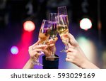 clinking glasses of champagne... | Shutterstock . vector #593029169