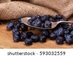 blueberries and silver spoon on ... | Shutterstock . vector #593032559