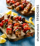 grilled skewers with vegetables ... | Shutterstock . vector #593042381