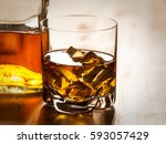 one glass of whiskey on the... | Shutterstock . vector #593057429