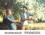 friends is enjoying fishing.... | Shutterstock . vector #593060201