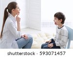 cute little boy at speech... | Shutterstock . vector #593071457