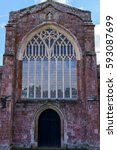 Small photo of Crediton Parish Church of the Holy Cross and the Mother of Him Who Hung thereon as seen from back entrance with stained glass, Devon, UK, March 4, 2017