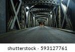 asphalt road under the steel... | Shutterstock . vector #593127761