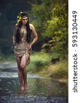 Small photo of Mysterious image of a beautiful woman in woods. Lonely mysterious girl on background of wild nature. Woman in search of herself. American indian