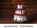 strawberry cake on a wooden... | Shutterstock . vector #593133641