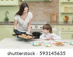 young happy mother and her... | Shutterstock . vector #593145635