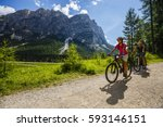 Mountain Biking Woman And Youn...