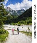 mountain biking woman and young ... | Shutterstock . vector #593146265