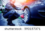 car mechanic installing sensor... | Shutterstock . vector #593157371