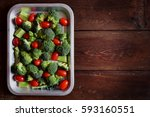 top view of fresh broccoli... | Shutterstock . vector #593160551