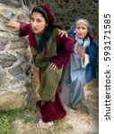 mary and mary magdalene leaving ... | Shutterstock . vector #593171585