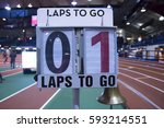 Small photo of A lap counter is set up next to the finish line to let the runners know how many laps to go in an indoor track and field arena