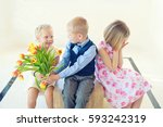 toddler blond boy gives a... | Shutterstock . vector #593242319