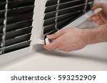 male hands installing window... | Shutterstock . vector #593252909