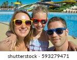 happy family taking selfie on... | Shutterstock . vector #593279471