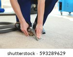 dry cleaner's employee removing ... | Shutterstock . vector #593289629
