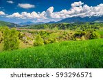 spring alpine landscape with... | Shutterstock . vector #593296571