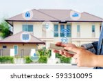 hand using smart phone as smart ... | Shutterstock . vector #593310095