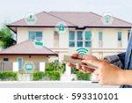 hand using smart phone as smart ... | Shutterstock . vector #593310101
