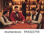 group of men playing poker in... | Shutterstock . vector #593322755