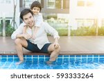 happy father and son resting in ... | Shutterstock . vector #593333264