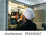technician is measuring voltage ... | Shutterstock . vector #593345267