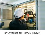 technician is measuring voltage ... | Shutterstock . vector #593345324