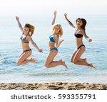 three young playful girls...   Shutterstock . vector #593355791