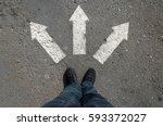 arrow on asphalt leg top view... | Shutterstock . vector #593372027