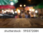 empty wood table top and blur... | Shutterstock . vector #593372084