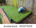 artificial grass being... | Shutterstock . vector #593379209