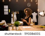 a young fashion designer on her ... | Shutterstock . vector #593386031