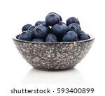 blueberries in bowl  on white... | Shutterstock . vector #593400899