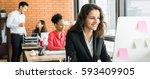 businesswoman working in... | Shutterstock . vector #593409905