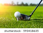 golf club and ball in grass and ... | Shutterstock . vector #593418635