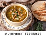 mushroom soup in ceramic  bowl | Shutterstock . vector #593450699