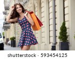 fashionably dressed woman on... | Shutterstock . vector #593454125