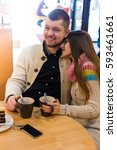 lovely couple sitting in a... | Shutterstock . vector #593461661