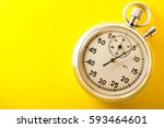 stopwatch on yellow background... | Shutterstock . vector #593464601