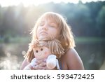 Girl With A Doll In His Hands...