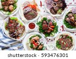 assortment of grilled meat... | Shutterstock . vector #593476301