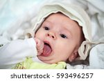 little baby boy chewing on... | Shutterstock . vector #593496257