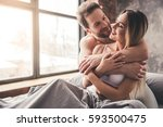 beautiful couple is smiling and ... | Shutterstock . vector #593500475