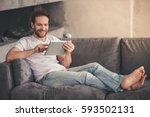 handsome man is using a digital ... | Shutterstock . vector #593502131