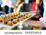 waiter carrying plates with... | Shutterstock . vector #593553914