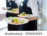 waiter carrying plates with... | Shutterstock . vector #593553929