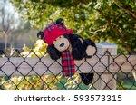 a fun stuffed bear makes an... | Shutterstock . vector #593573315