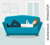 young man lying on the couch at ... | Shutterstock . vector #593662529